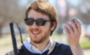smiling blind man with cane and phone_edited.jpg
