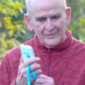blind man walking with a phone.jpg