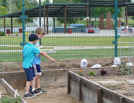 Playground group in garden, finding mari