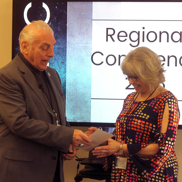 Dr Ford presents AEBC ministerial degree to Mona Southworth