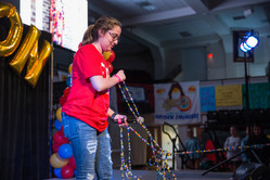 Lindsey shows her Bravery Beads while sharing her story on stage.