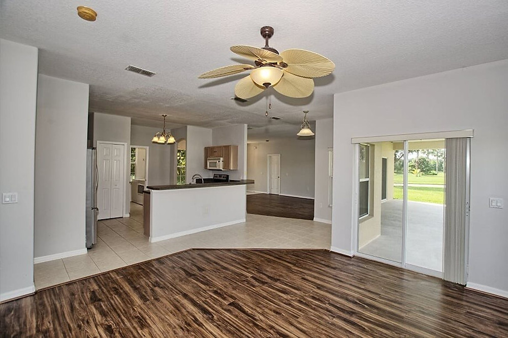Family room opens to the kitchen, laundry room, and two-car garage.