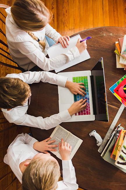 children-doing-homework-with-laptop.jpg