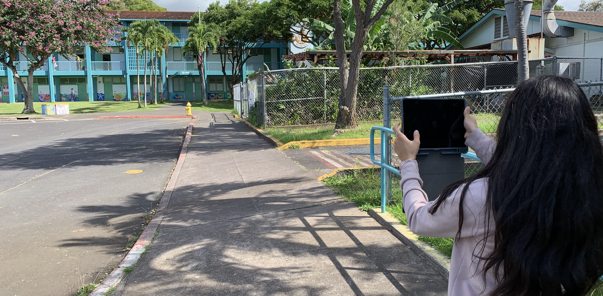 student taking photo of school