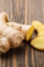 Ginger root sliced on wooden table.jpg