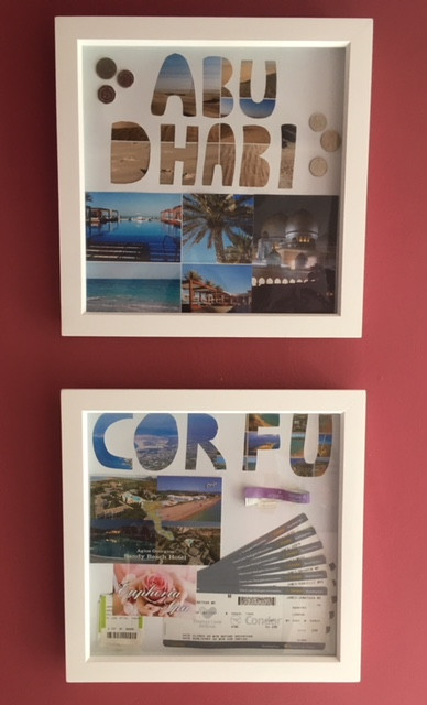 2 white frames containing country name, photographs and souvenirs from the holiday.