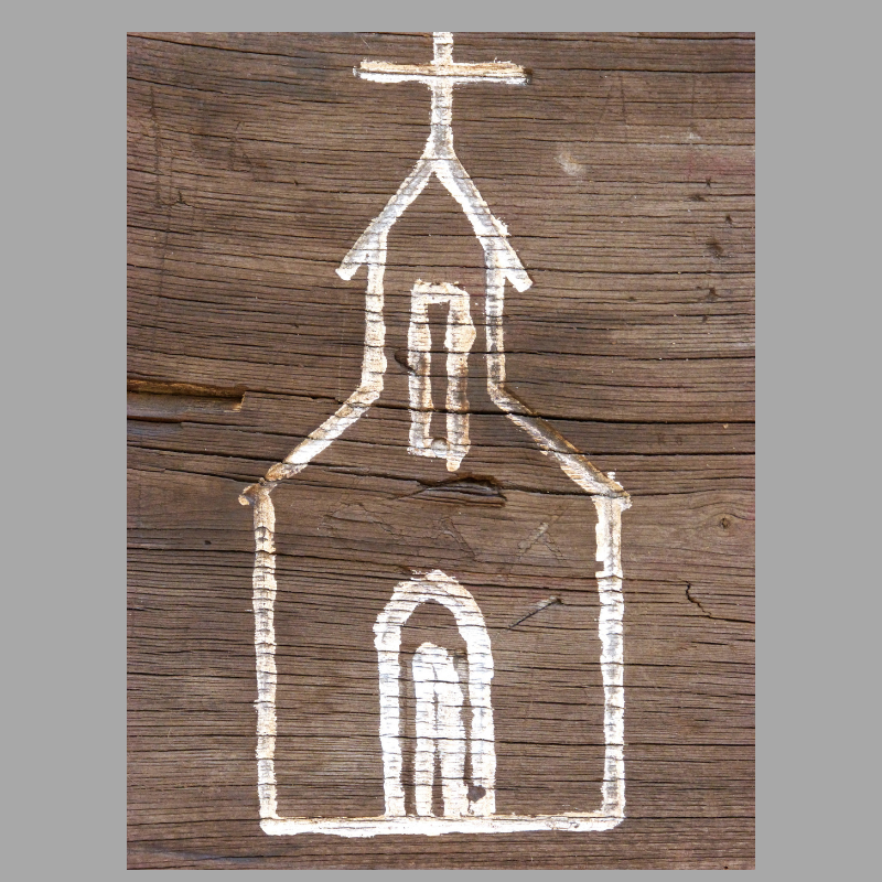 simple hand drawn outline of a church in white on a dark brown, wood grain background