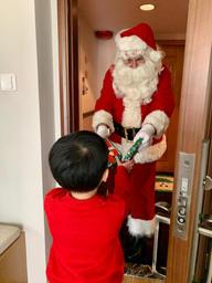 Santa surprising children