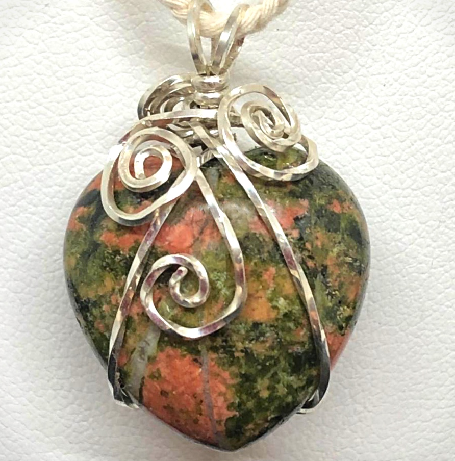 Front of Sterling Silver Wire wrapt Unakite heart pendants