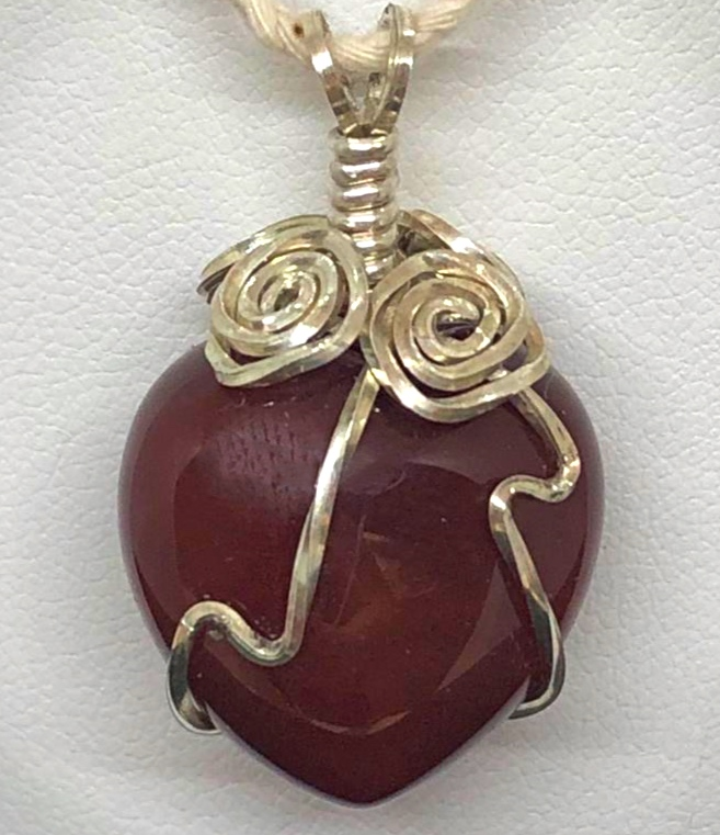 Front of Sterling Silver Wire wrapt Carnelian heart pendants