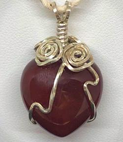 Front of Sterling Silver Wire wrapt Carnelian heart pendants