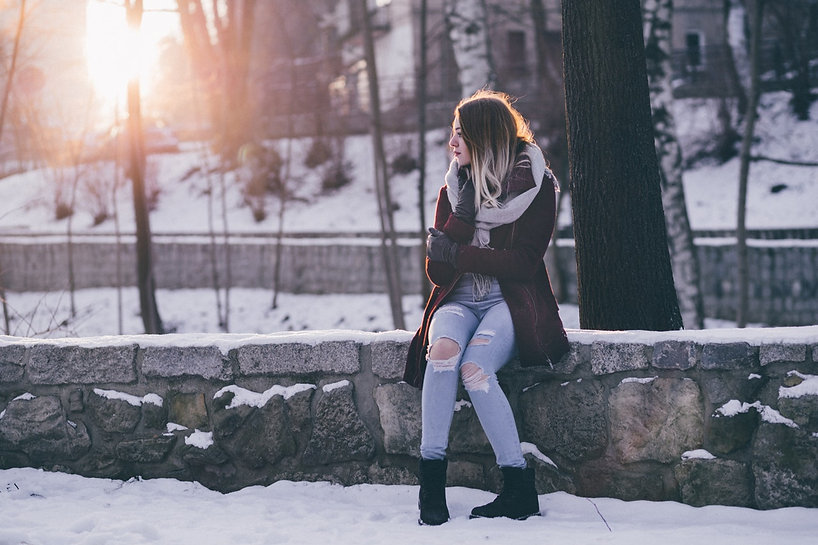 woman-sitting-in-the-park-with-snow-3183