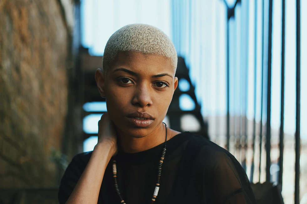 black-woman-with-short-hair-looking-at-c