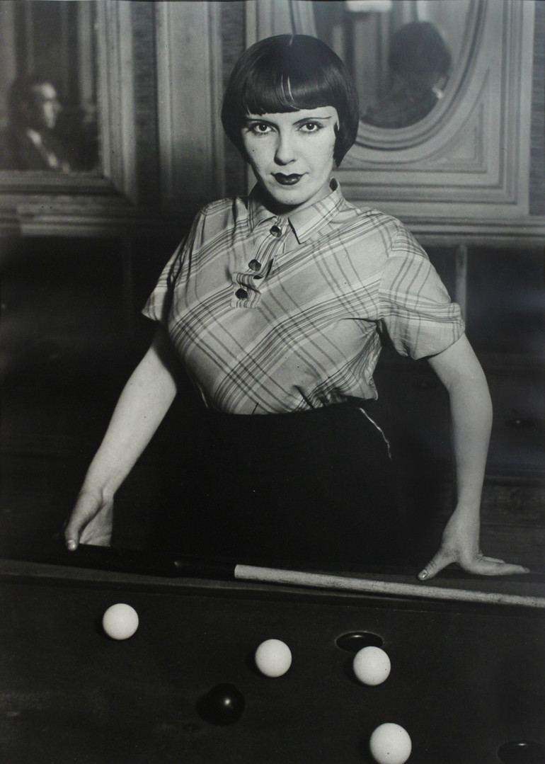 """Brassaï, """"A prostitute playing Russian billiards, Boulevard Rochechouart, Montmartre, c. 1932"""", gelatin silver print, 15 3/8 x 11 1/4 in. (39.05 x 28.58 cm), courtesy of The Museum of Contemporary Art, Los Angeles, The Ralph M. Parsons Foundation Photography Collection"""