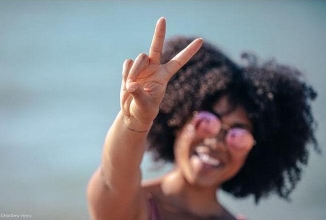 black_woman_waving_peace_sign.jpg