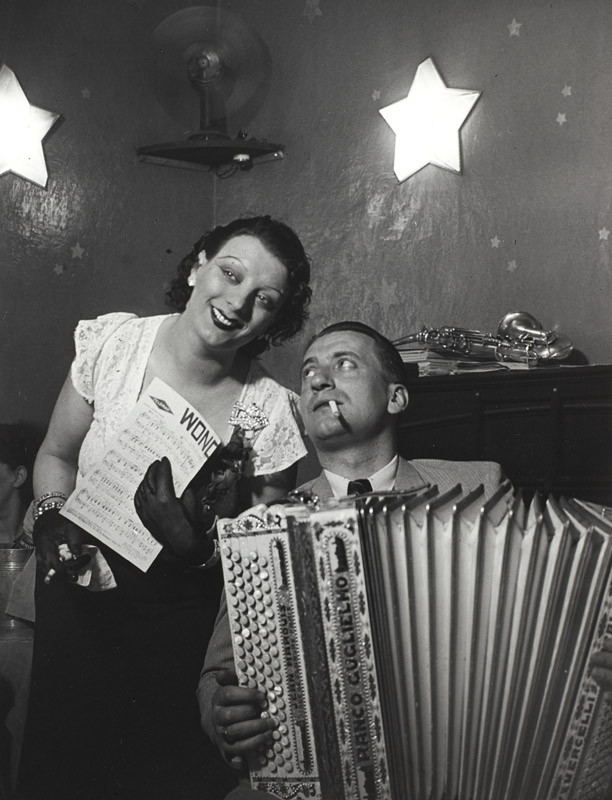 "Brassaï, ""Kiki with her accordion player at the Cabaret des Fleurs, Rue de Montparnasse, c. 1932"", gelatin  silver print, courtesy of The Museum of Contemporary Art, Los Angeles, The Ralph M. Parsons Foundation Photography Collection"