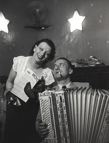 """Brassaï, """"Kiki with her accordion player at the Cabaret des Fleurs, Rue de Montparnasse, c. 1932"""", gelatin  silver print, courtesy of The Museum of Contemporary Art, Los Angeles, The Ralph M. Parsons Foundation Photography Collection"""