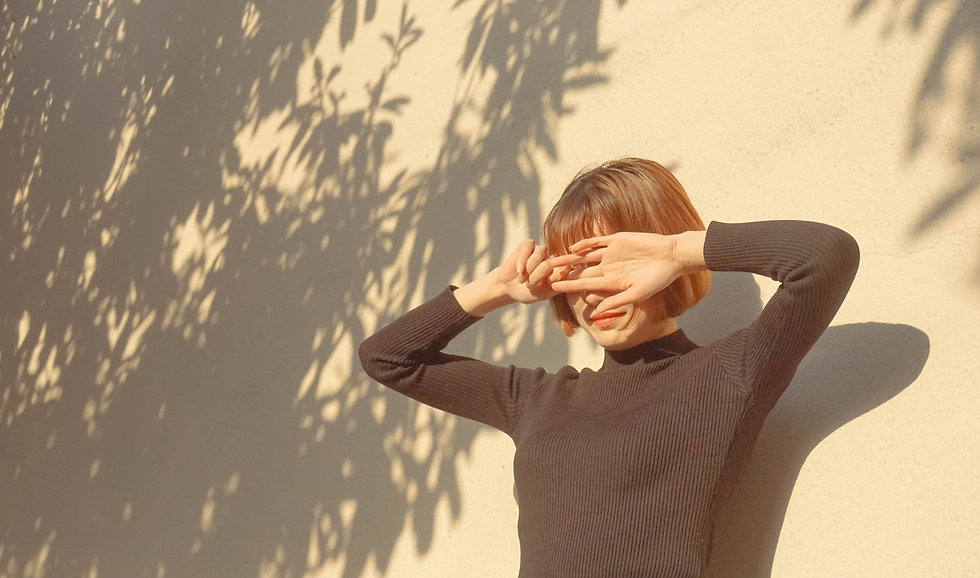woman_covering_her_eyes_from_the_sun.jpg