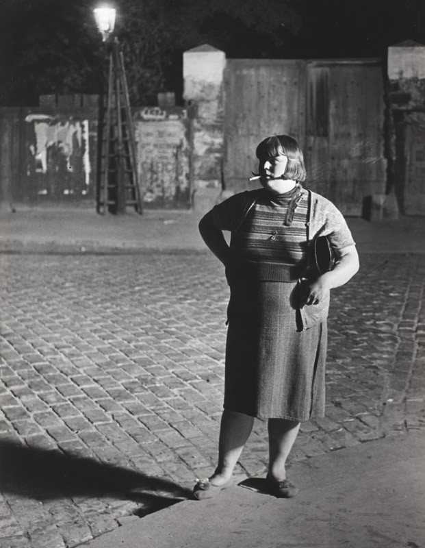 "Brassaï, ""Streetwalker near the Place d'Italie, c. 1932"", gelatin silver print, 12 x 8 3/4 in. (30.48 x 22.23 cm), courtesy of The Museum of Contemporary Art, Los Angeles, The Ralph M. Parsons Foundation Photography Collection"