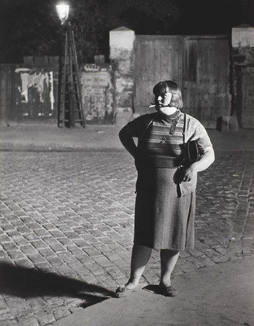 """Brassaï, """"Streetwalker near the Place d'Italie, c. 1932"""", gelatin silver print, 12 x 8 3/4 in. (30.48 x 22.23 cm), courtesy of The Museum of Contemporary Art, Los Angeles, The Ralph M. Parsons Foundation Photography Collection"""