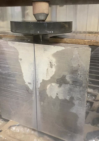 Waterjetting 8 inch slab of Inconel.