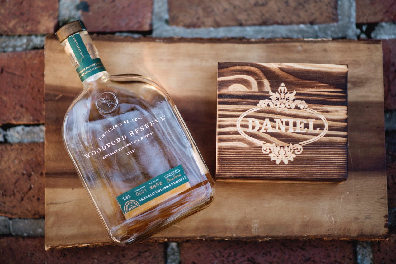 Give your man a way to slam back in class with a set of personalized shot glasses that will dance out of their box.  This twosome is meant to be cherished at the Man Cave bar, as they're presented out of a case of timber which makes a splash all its own.