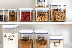 Baking ingredients in BPA-free plastic storage containers with labels.jpg