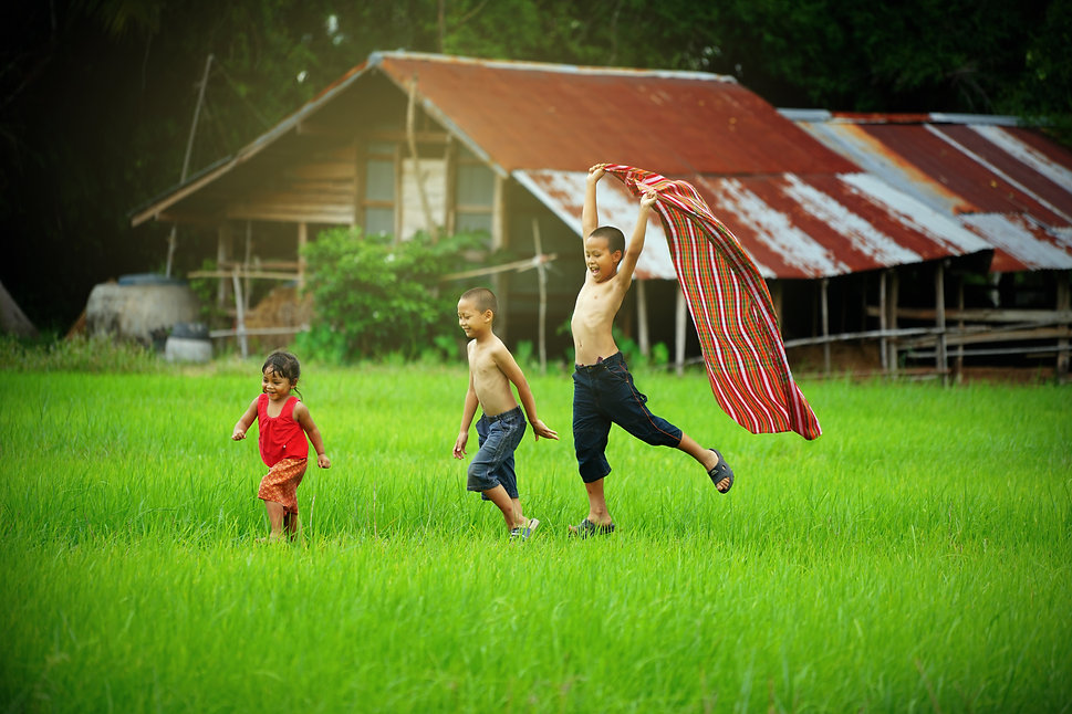 Children runing in the backyard of their