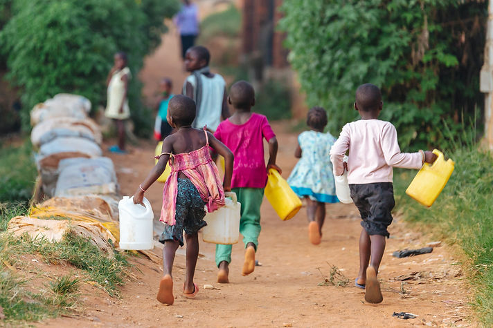 Children carrying water cans in Uganda,