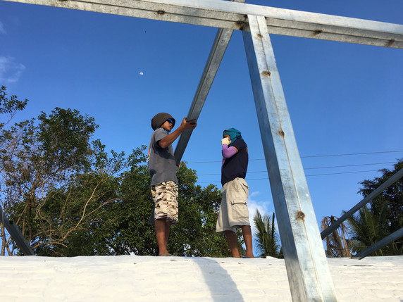 Local craftsmen Rafael and Eugene were installing beams for an additional roof