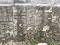 Old tarpaulins disfigured the exterior