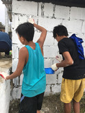 Local children of the Philippines were voluntarily painting the building