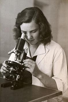 dark hair girl with the microscope - pho