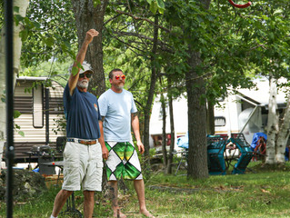 HORSING AROUND,  having a friendly game of horseshoes, there's always something to do at the cam