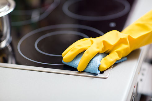 hand-with-rag-cleaning-cooker-at-home-ki
