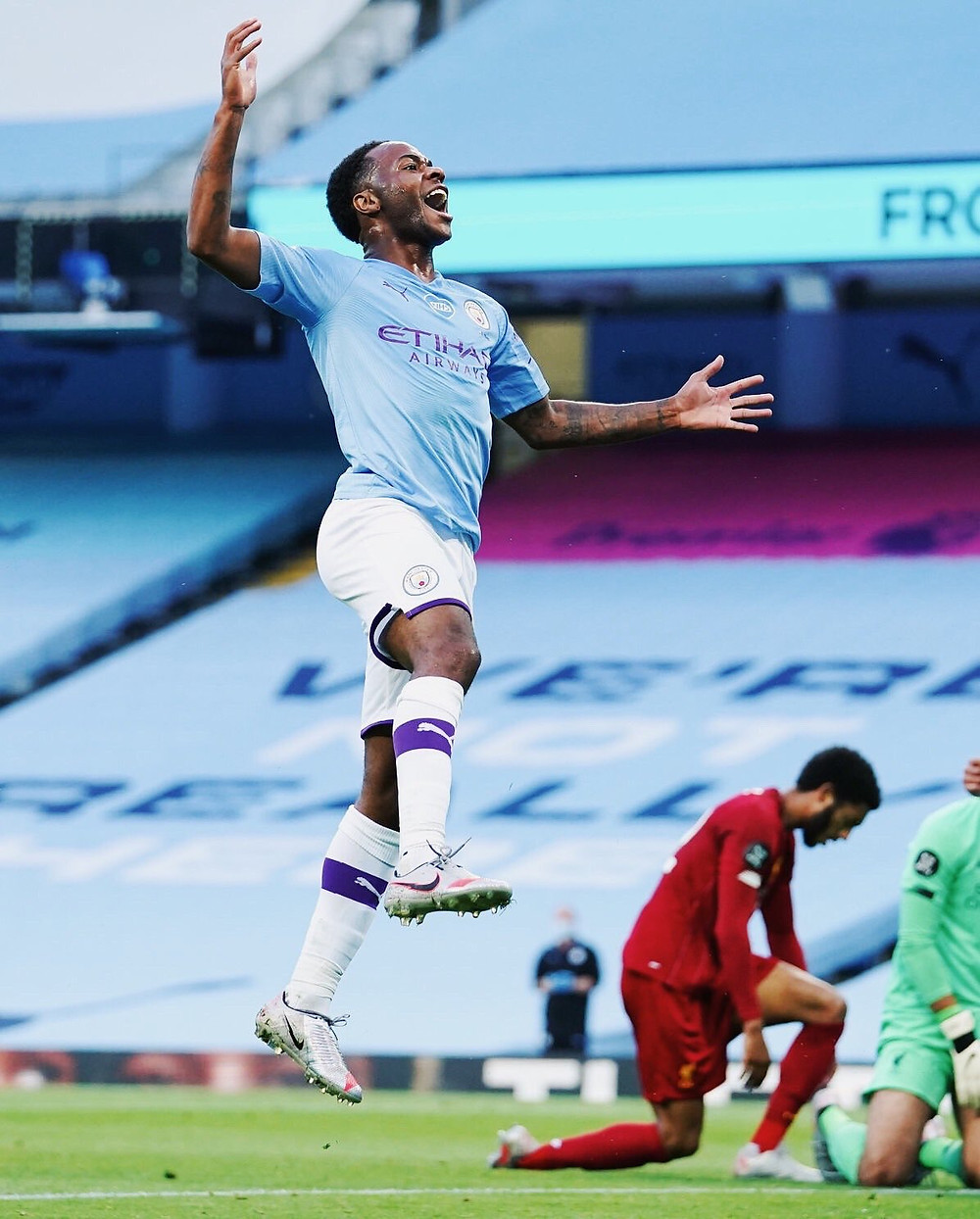 Mannchester City's Raheem Sterling celebrates after scoring past arch rival Joe Gomez