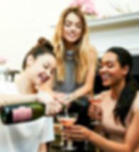 girls sharing champaign.jpg