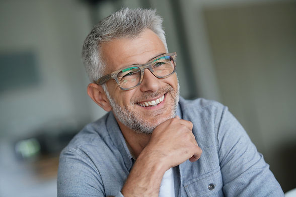 Middle-aged guy with trendy eyeglasses.j