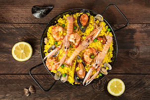 A photo of a Spanish seafood paella in a