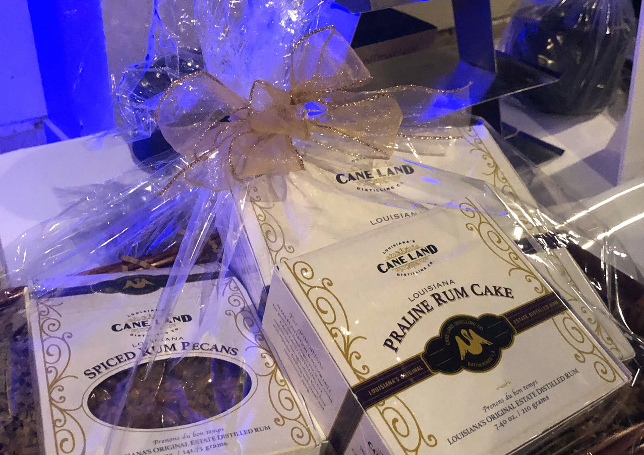 gift basket of Cane Land pecans and rum cake in bask