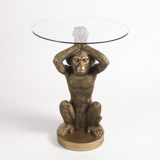 Glass topped gold monkey table