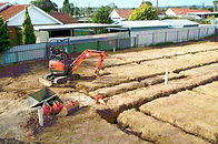 Excavate house footings for foundations