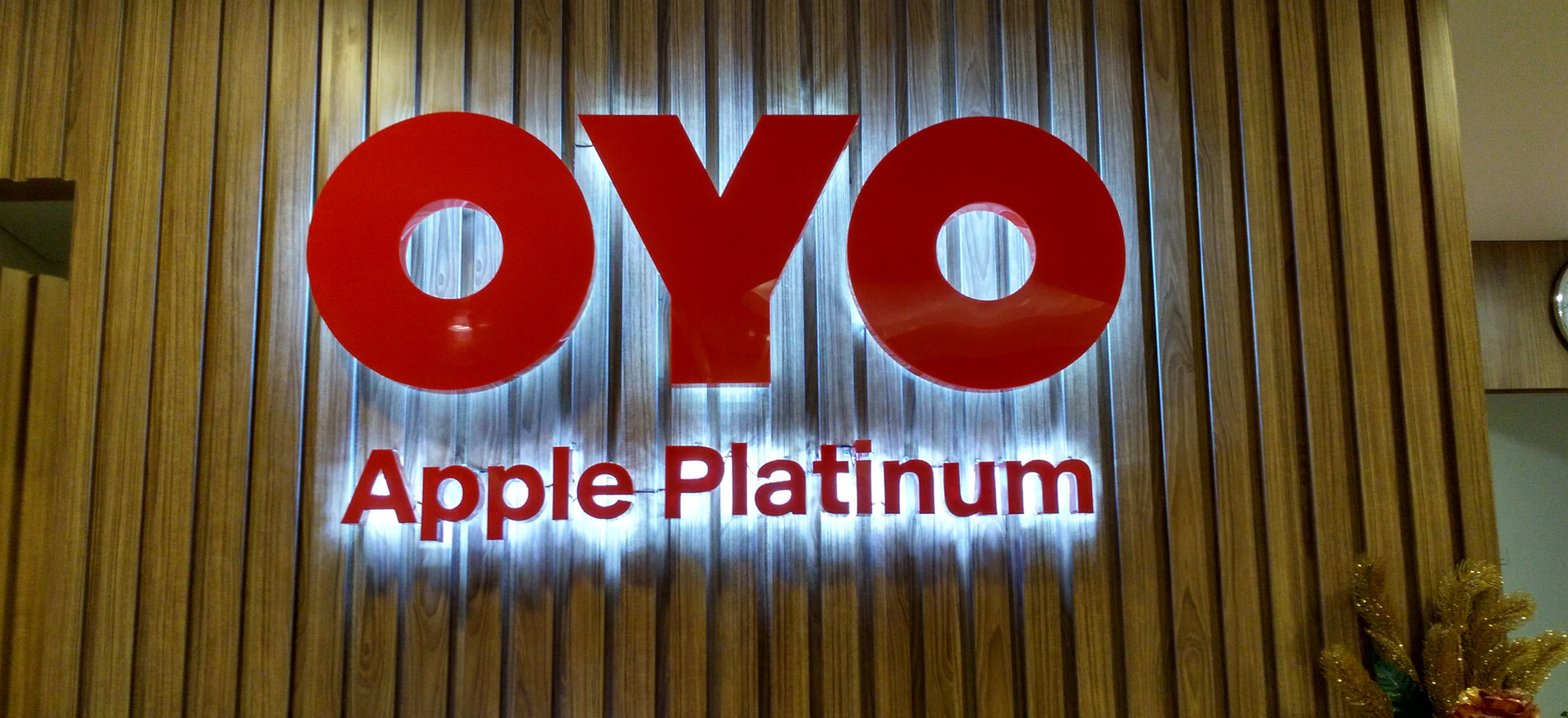 OYO Apple Platinum Receiptionist Signage