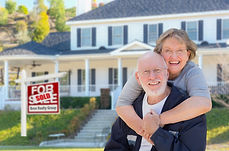 senior couple with sold house sign_edted