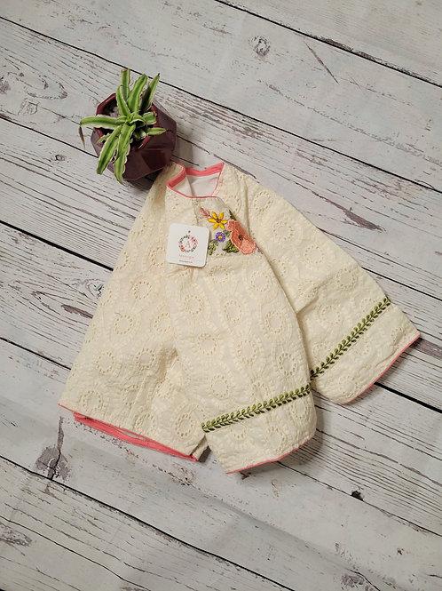 Half white chikankari blouse with hand embroidery work