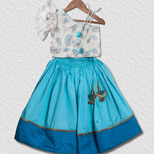 White floral cotton crop top paired with blue double tone silk lehanga for girls