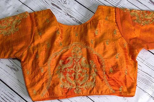 Orange color zari embroidery blouse for Indian sari