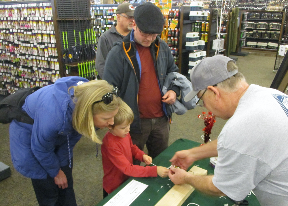 A club member teaching future anglers how to tie knots.