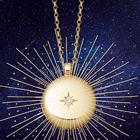 Glowing golden pendant with a star imprint on a blue background.