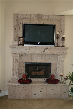 CANTERA HAND CARVED FIREPLACE FP060.jpg